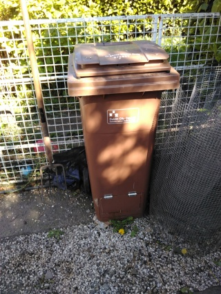 Narrow compost wheelie bin, repurposed for backyard use