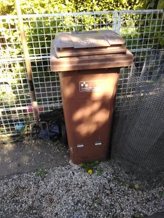 Narrow compost wheelie bin, repurposed for backyard use